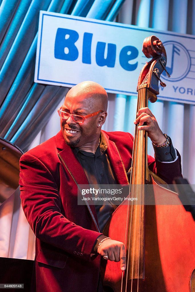 American Jazz musician <a gi-track='captionPersonalityLinkClicked' href=/galleries/search?phrase=Christian+McBride&family=editorial&specificpeople=2558745 ng-click='$event.stopPropagation()'>Christian McBride</a> plays upright acoustic bass as he performs onstage with <a gi-track='captionPersonalityLinkClicked' href=/galleries/search?phrase=Roy+Haynes&family=editorial&specificpeople=873496 ng-click='$event.stopPropagation()'>Roy Haynes</a> and his Fountain of Youth Band on Haynes' 90th birthday at the Blue Note, New York, New York, March 13, 2015.