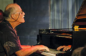 American Jazz musician Don Friedman plays piano as he performs during Hank Jones' 85th birthday celebration at the Blue Note nightclub New York New...