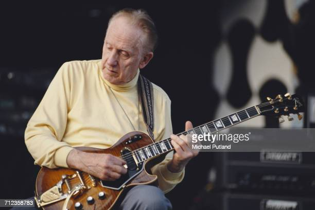 American jazz musician Les Paul performs live on stage playing a Gibson guitar at the Guitar Legends concert in Seville Spain in October 1991