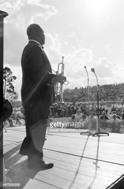 American jazz musician Louis Armstrong and his AllStar Band performs at an outdoor venue during a tour of Africa late 1960