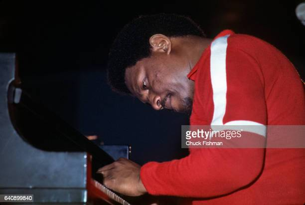 American Jazz musician McCoy Tyner plays piano as he performs during the New Orleans Jazz Heritage Festival at the Fair Grounds Race Course New...