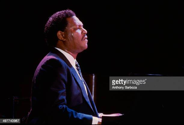 American jazz musician McCoy Tyner plays piano on stage during the 'One Night With Blue Note' concert at Town Hall New York New York February 22 1985