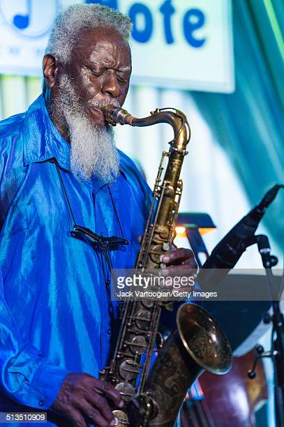 American Jazz musician Pharoah Sanders plays tenor saxophone during a performance with the Odean Pope Sextet at The Blue Note New York New York...