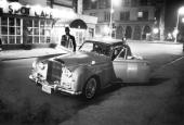 American jazz musician Thelonious Monk and his patron British Baroness Nica de Koenigswarter get into the latter's Bentley outside the Five Spot Cafe...