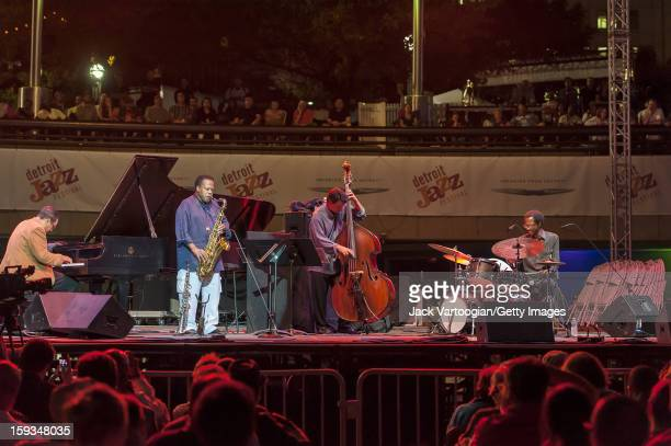 American jazz musician Wayne Shorter plays tenor saxophone as he performs with his Quartet on the Carhartt Amphitheatre Stage at the Detroit Jazz...