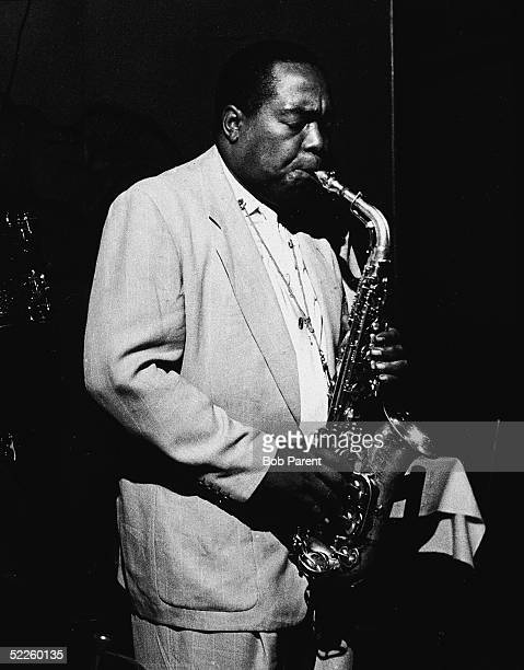 American jazz saxophonist and composer Charlie Parker closes his eyes as he plays the alto saxophone during a performance at the Open Door cafe in...