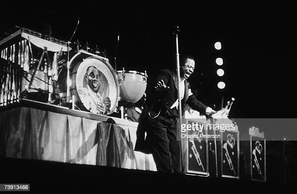 American jazz singer and trumpeter Louis Armstrong performs with his orchestra at the Paramount Theater in New York May 1937