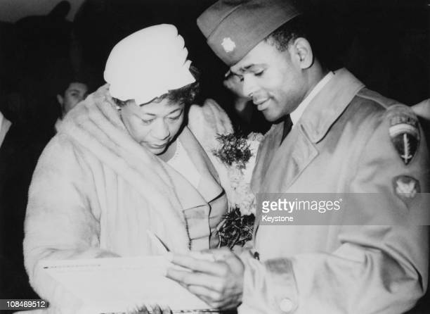 American jazz singer Ella Fitzgerald signs an autograph dor an American serviceman at an airport in Berlin 10th February 1960