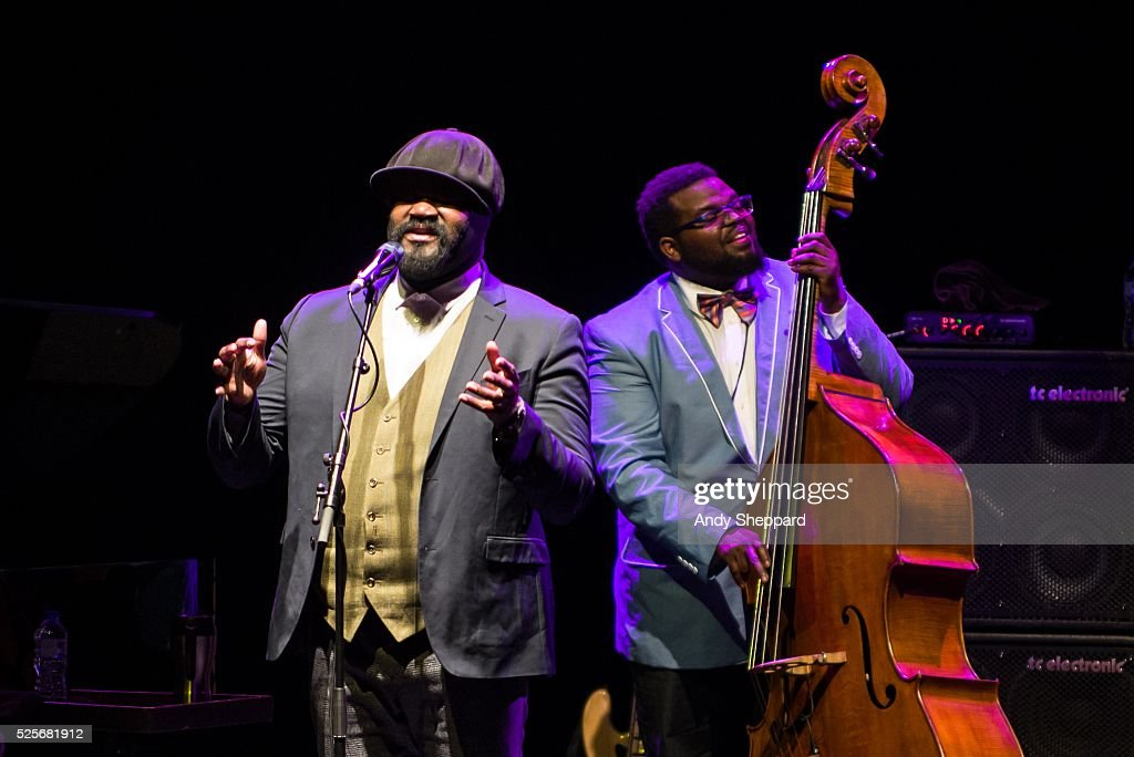 American Jazz singer Gregory Porter and bass player Jahmal Nichols perform on stage at Eventim Apollo on April 28, 2016 in London, England.