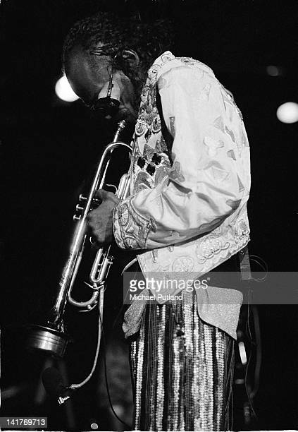 American jazz trumpeter and composer Miles Davis performs on stage London July 1983