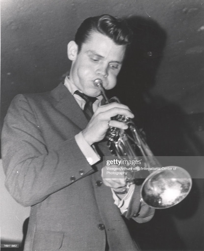 American jazz trumpeter and singer Chet Baker (1929 - 1988) (born Chesney Henry Baker Jr) performs onstage, late 1940s or early 1950s. (Photo by Weegee(Arthur Fellig)/International Center of Photography/Getty Images)