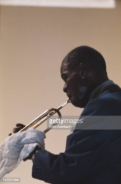 American jazz trumpeter and singer Louis Armstrong performing circa 1956