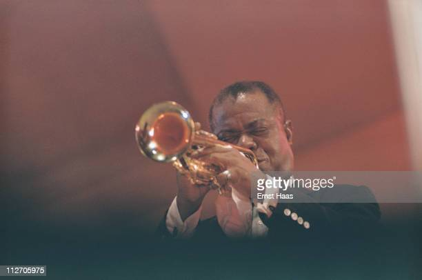 American jazz trumpeter and singer Louis Armstrong performs at the Newport Jazz Festival in Rhode Island 1958