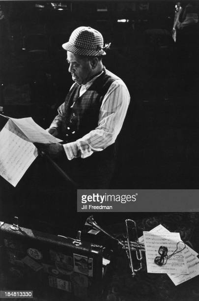 American jazz trumpeter bandleader and composer Dizzy Gillespie studies the score for 'Dizzy Gillespie Dream Band Jazz America' during rehearsals New...
