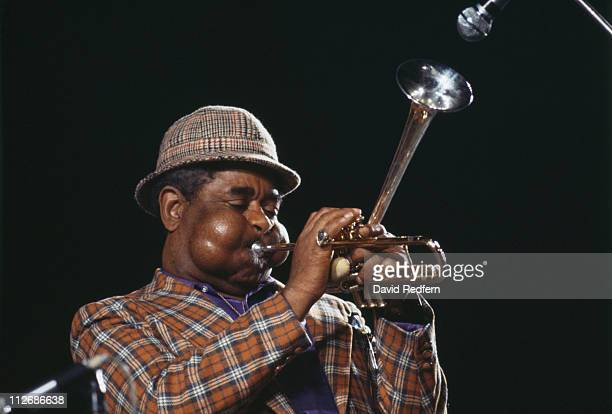 Dizzy Gillespie US jazz trumpeter and band leader playing his distinctive 'bent' trumpet during a live concert performance circa 1980