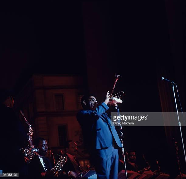 American jazz trumpeter Dizzy Gillespie performs on stage circa 1965