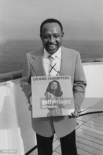 American jazz vibraphonist pianist and percussionist Lionel Hampton holds his album on board a jazz cruise 1974