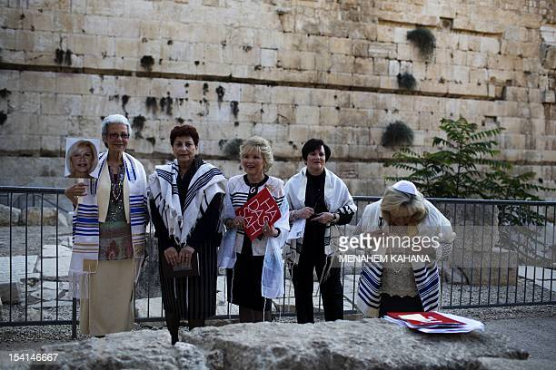 American Jewish women from Florida wearing the Talit celebrate during their late Bat Mitzvah which is the Jewish tradition maturity ceremony usually...