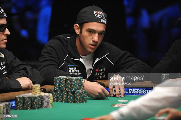 American Joseph Cada organizes his chips during a hand at the final table at the 2009 World Series of Poker at the Penn Teller Theater at the Rio...