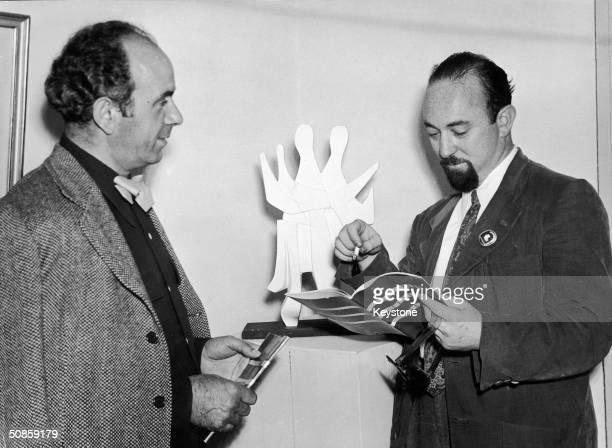 American journalist Melvin J Lasky with a German artist at an artist's convention at Charlottenburg castle Germany circa 1950 Lasky was the founder...