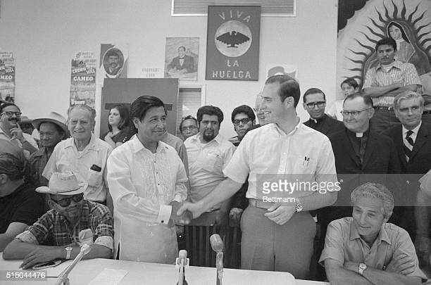 Cesar Chavez shaking hands with John Giumarra Jr representing 26 of the California's largest table grape growers ending the fiveyear boycott of table...
