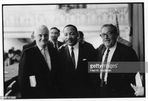 American labor leader Harry van Arsdale Jr and Civil Rights and Religious leader Reverend Martin Luther King Jr pose with an unidentified man...
