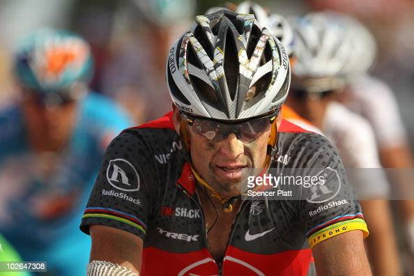 American Lance Armstrong with team RadioShack arrives over the finish along the 213km stage three of the Tour de France on July 6 2010 in Arenberg...