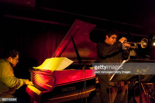 American Latin Jazz composer bandleader and musician Arturo O'Farrill plays piano as he leads his quartet with his son Adam O'Farrill on trumpet on...