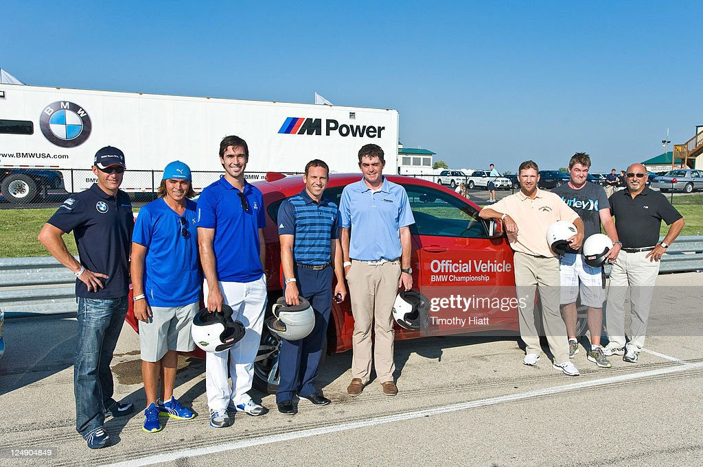 BMW American Le Mans Series race driver Joey Hand and PGA TOUR players Rickie Fowler, Cameron Tringale, Sergio Garcia, Keegan Bradley, George McNeil, Mark Leishman, and legendary race car diver Bobby Rahal help kick- off the BMW Championship by driving at a race track for charity at Autobahn Racetrack on September 13, 2011 in Joliet, Illinois.