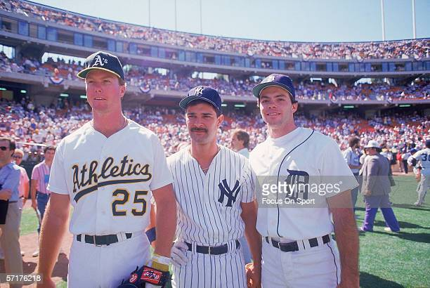 American League All Stars Mark McGwire of the Oakland Athletics Don Mattingly of the New York Yankees and Matt Nokes of the Detroit Tigers pose for...