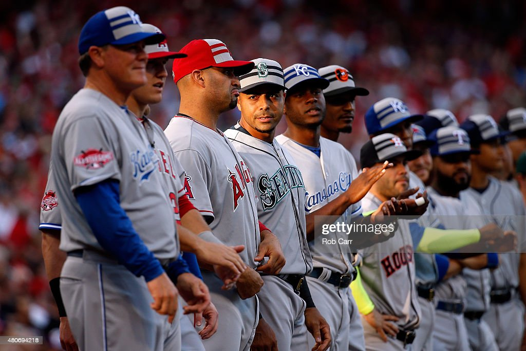 American League All-Star <a gi-track='captionPersonalityLinkClicked' href=/galleries/search?phrase=Albert+Pujols&family=editorial&specificpeople=171151 ng-click='$event.stopPropagation()'>Albert Pujols</a> #5 of the Los Angeles Angels of Anaheim talks with American League All-Star <a gi-track='captionPersonalityLinkClicked' href=/galleries/search?phrase=Nelson+Cruz&family=editorial&specificpeople=235459 ng-click='$event.stopPropagation()'>Nelson Cruz</a> #23 of the Seattle Mariners during player introductions prior to the 86th MLB All-Star Game at the Great American Ball Park on July 14, 2015 in Cincinnati, Ohio.