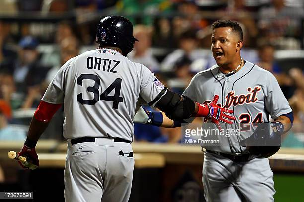 American League AllStar David Ortiz of the Boston Red Sox greets American League AllStar Miguel Cabrera of the Detroit Tigers after Cabrera scored in...