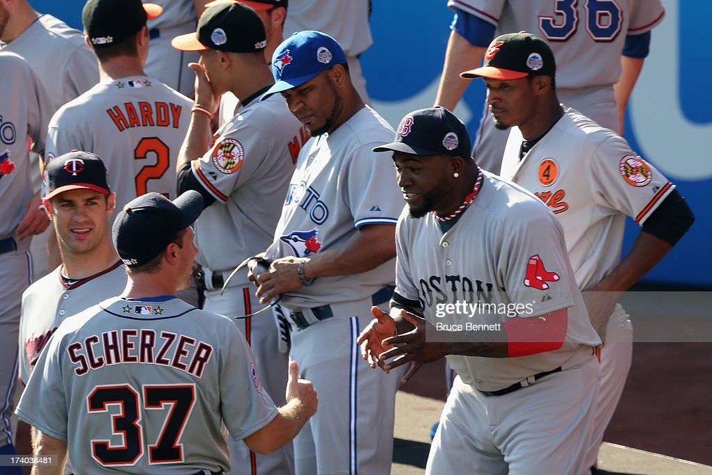 American League All-Star David Ortiz #34 of the Boston Red Sox talks with American League All-Star Max Scherzer #37 of the Detroit Tigers during the 84th MLB All-Star Game on July 16, 2013 at Citi Field in the Flushing neighborhood of the Queens borough of New York City.