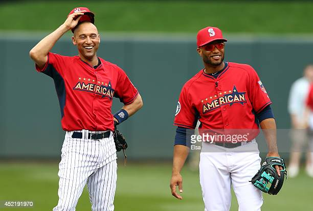American League AllStar Derek Jeter of the New York Yankees speaks with American League AllStar Robinson Cano of the Seattle Mariners during batting...