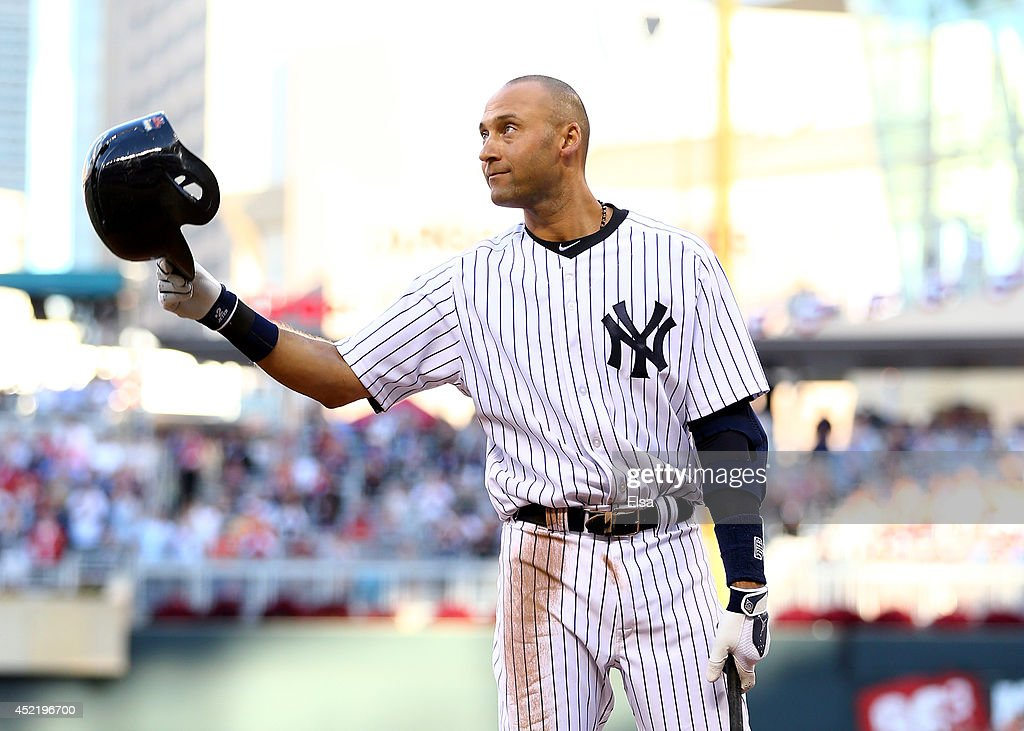 American League All-Star <a gi-track='captionPersonalityLinkClicked' href=/galleries/search?phrase=Derek+Jeter&family=editorial&specificpeople=167125 ng-click='$event.stopPropagation()'>Derek Jeter</a> #2 of the New York Yankees acknowledges the crowd before his first at bat during the 85th MLB All-Star Game at Target Field on July 15, 2014 in Minneapolis, Minnesota.