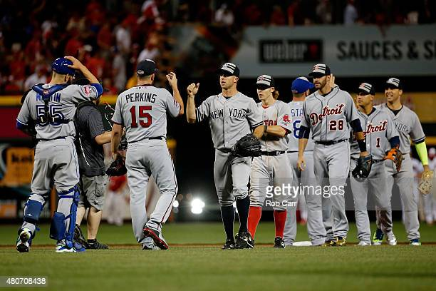 American League AllStar Glen Perkins of the Minnesota Twins celebrates with teammates after defeating the National League AllStars 63 in the 86th MLB...