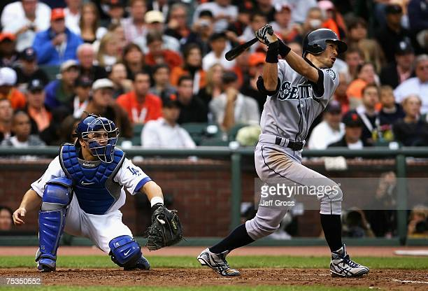 American League AllStar Ichiro Suzuki of the Seattle Mariners follows through on an inside the park home run in the fifth inning of the 78th Major...