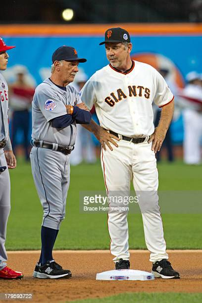American League AllStar manager Jim Leyland of the Detroit Tigers talks with National League AllStar manager Bruce Bochy of the San Francisco Giants...