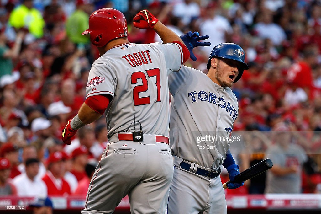 American League AllStar Mike Trout of the Los Angeles Angels of Anaheim celebrates with teammate American League AllStar Josh Donaldson of the...