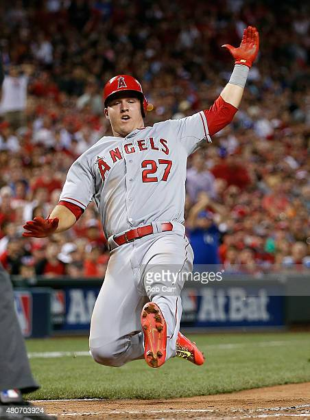 American League AllStar Mike Trout of the Los Angeles Angels of Anaheim slides home to score off of American League AllStar Prince Fielder of the...