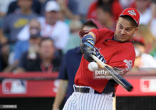 American League AllStar Nick Swisher of the New York Yankees swings the bat during the first round of the 2010 State Farm Home Run Derby during...
