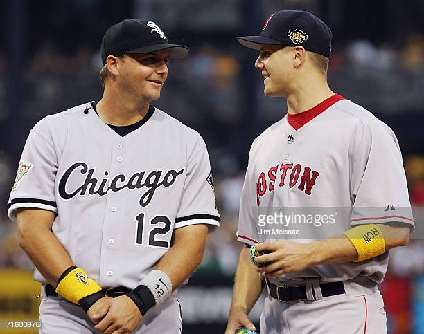 American League AllStar pitcher Jonathan Papelbon of the Boston Red Sox talks with catcher AJ Pierzynski of the Chicago White Sox before playing the...