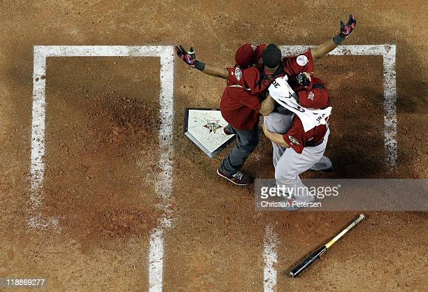 American League AllStar Robinson Cano of the New York Yankees celebrates after winning the 2011 State Farm Home Run Derby at Chase Field on July 11...