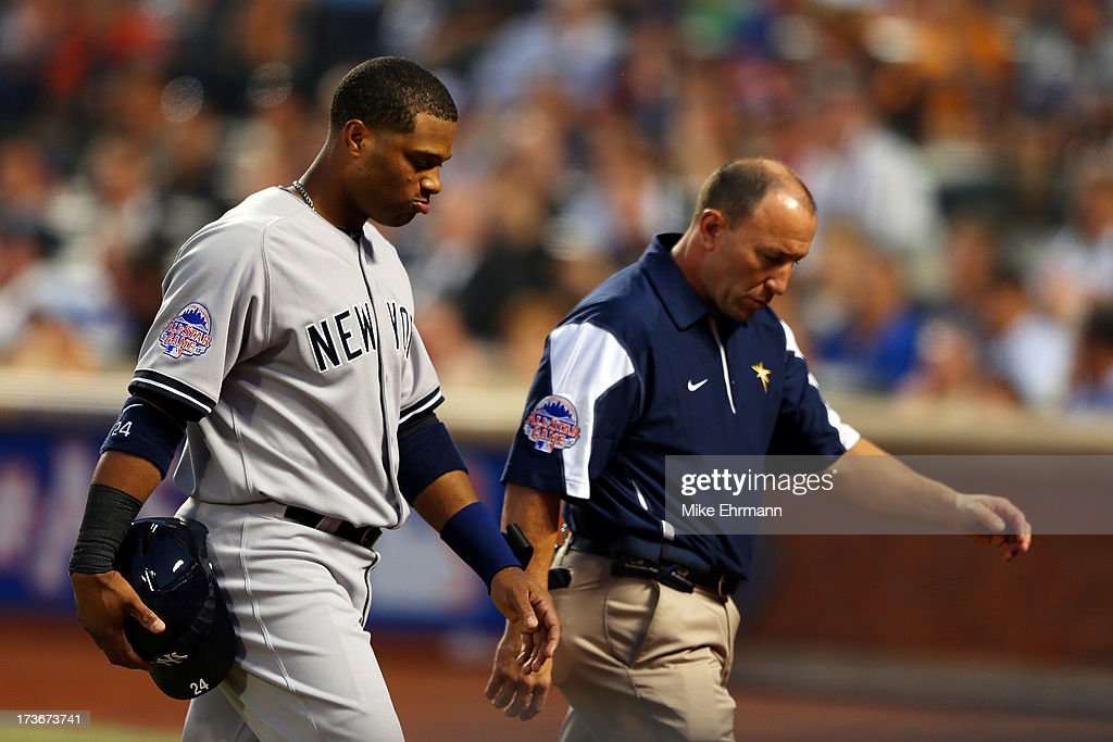 American League All-Star <a gi-track='captionPersonalityLinkClicked' href=/galleries/search?phrase=Robinson+Cano&family=editorial&specificpeople=538362 ng-click='$event.stopPropagation()'>Robinson Cano</a> #24 of the New York Yankees comes out of the game after being hit by a pitch in the first inning during the 84th MLB All-Star Game on July 16, 2013 at Citi Field in the Flushing neighborhood of the Queens borough of New York City.