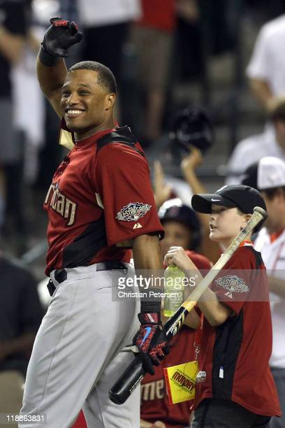 American League AllStar Robinson Cano of the New York Yankees reacts in the second round of the 2011 State Farm Home Run Derby at Chase Field on July...