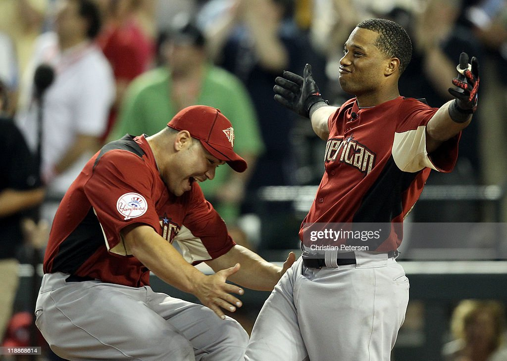 American League All-Star Robinson Cano #24 of the New York Yankees reacts with teammate Russell Martin #55 of the New York Yankees in the final round of the 2011 State Farm Home Run Derby at Chase Field on July 11, 2011 in Phoenix, Arizona. Cano won the 2011 State Farm Home Run Derby with a recond 12 home runs in the final round.