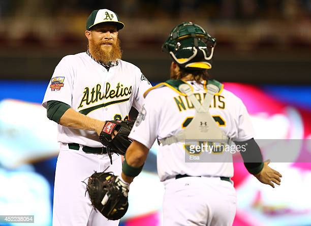 American League AllStar Sean Doolittle of the Oakland Athletics speaks with teammate Star Derek Norris against the National League AllStars during...