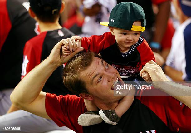 American League AllStar Sonny Gray of the Oakland Athletics plays with his son Gunnar during the Gillette Home Run Derby presented by Head Shoulders...