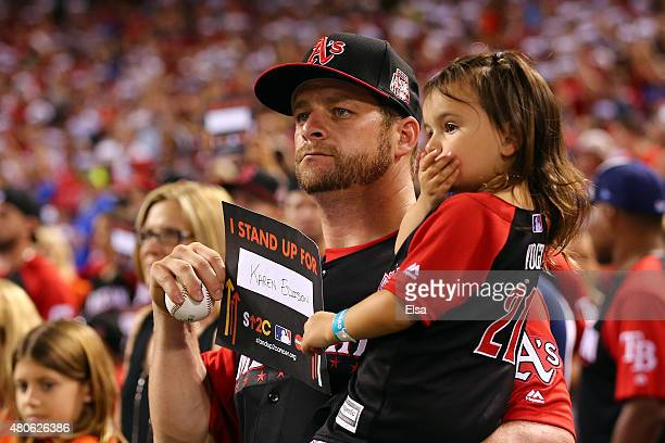 American League AllStar Stephen Vogt of the Oakland Athletics holds a 'Stand Up To Cancer' sign during the Gillette Home Run Derby presented by Head...