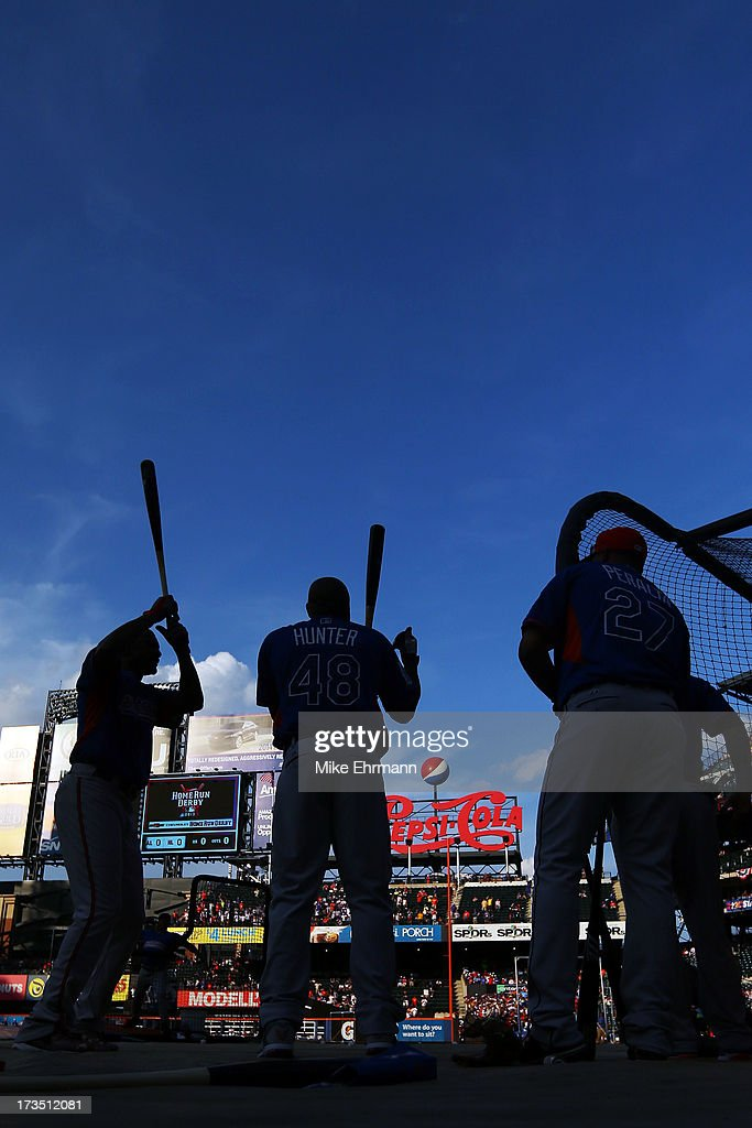 American League All-Star <a gi-track='captionPersonalityLinkClicked' href=/galleries/search?phrase=Torii+Hunter&family=editorial&specificpeople=183408 ng-click='$event.stopPropagation()'>Torii Hunter</a> of the Detroit Tigers and <a gi-track='captionPersonalityLinkClicked' href=/galleries/search?phrase=Jhonny+Peralta&family=editorial&specificpeople=213286 ng-click='$event.stopPropagation()'>Jhonny Peralta</a> #27 of the Detroit Tigers take batting practice during Gatorade All-Star Workout Day on July 15, 2013 at Citi Field in the Flushing neighborhood of the Queens borough of New York City.